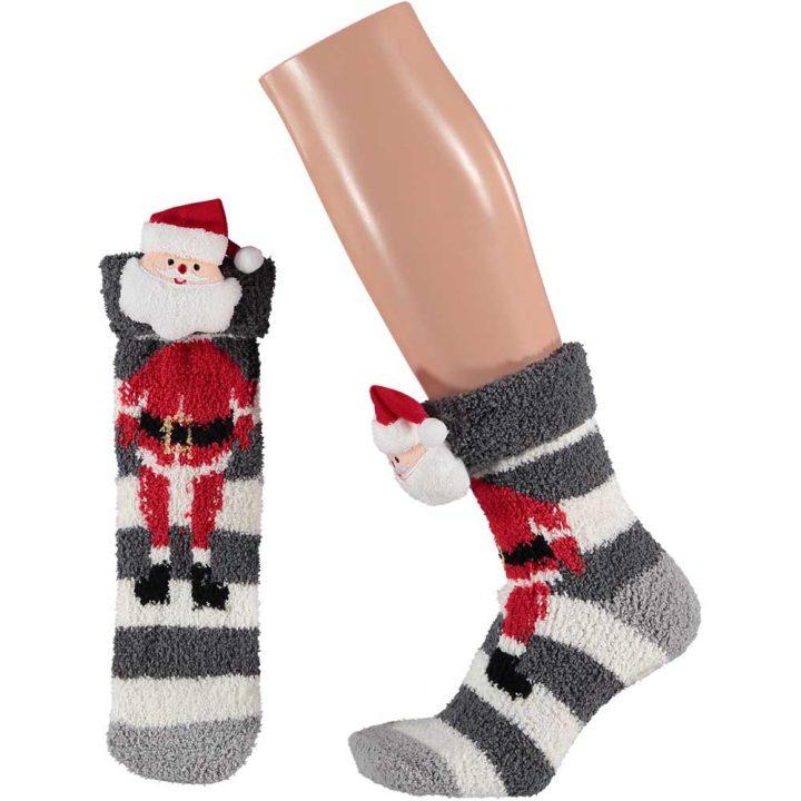 Aikuisten pörröiset sukat, joissa hauska jouluinen hahmo. Koko: One size. Malli: Joulupukki.