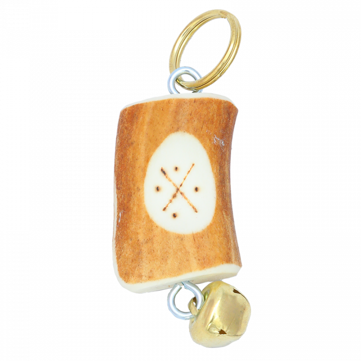 Key chain is handmade in Finland from reindeer antler. Key chain is decorated with traditional Lappish symbol and a bell. Each key chain is unique, size and symbol may vary. Size approx. 6cm-8cm.