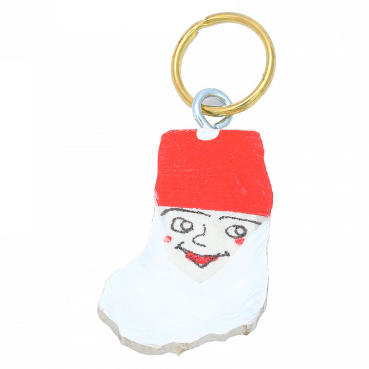 Key chain is handmade in Finland from reindeer antler and decorated with hand painted elf. Each key chain is unique, size may vary. Size approx. 7cm.