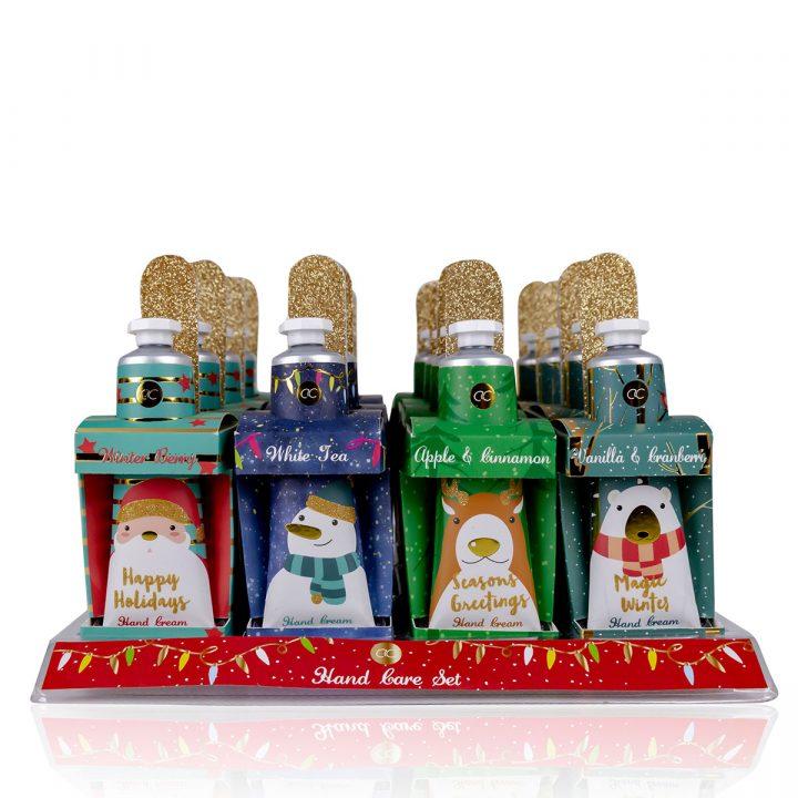 Käsienhoitosetti paperisessa lahjapaketissa, sisältää 30 ml käsi- & kynsivoide, kynsiviila, 4 mallia / tuoksua: Joulupukki/Winterberry, Lumiukko/White Tea, Poro/Apple &Cinnamon, Jääkarhu/Vanilla & Cranberry
