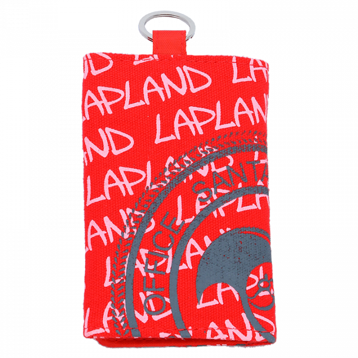 Joulunpunainen avattava lompakko, jossa on teksti Lapland ja Santa Claus Office logo. Lompakossa on tarrakiinnitys, kaksiosainen setelitasku, 4 paikkaa korteille ja kolikkotasku. Lompakon materiaali on canvas ja koko 12,5 x 8cm.