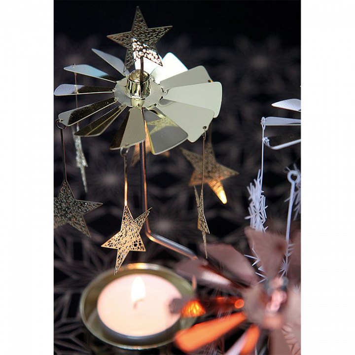 Rotary candle holder creates a cozy atmosphere and perfect as an interior detail. Just light the candle and watch the little metal star figures rotate. Candle holder is gold-coloured and comes in a box. 1 tealight candle is included. Height approx.17cm.