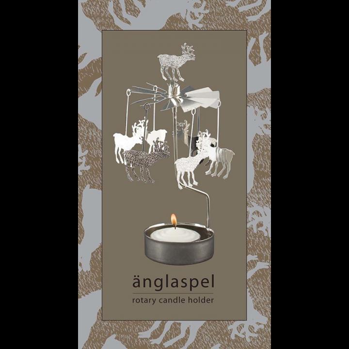 Hopeanvärinen kimaltava enkelikello, jossa porokoristeet pyörivät kynttilän palaessa. Enkelikello on kaunis koriste-esine ja mainio lahjaidea. Tuote on koottava ja se toimitetaan pakkauksessa, sisältää 1 kynttilän. Enkelikellon korkeus n.17cm.