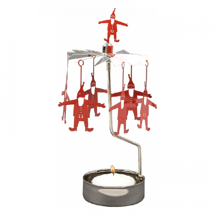 Rotary candle holder creates a cozy atmosphere and perfect as an interior detail. Just light the candle and watch the little metal santa figures rotate. Candle holder is gold-coloured with red details and comes in a box. 1 tealight candle is included. Height approx.17cm.
