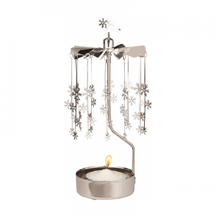 Rotary candle holder creates a cozy atmosphere and perfect as an interior detail. Just light the candle and watch the little metal snowflakes figures rotate. Candle holder is silver-coloured and comes in a box. 1 tealight candle is included. Height approx.17cm.