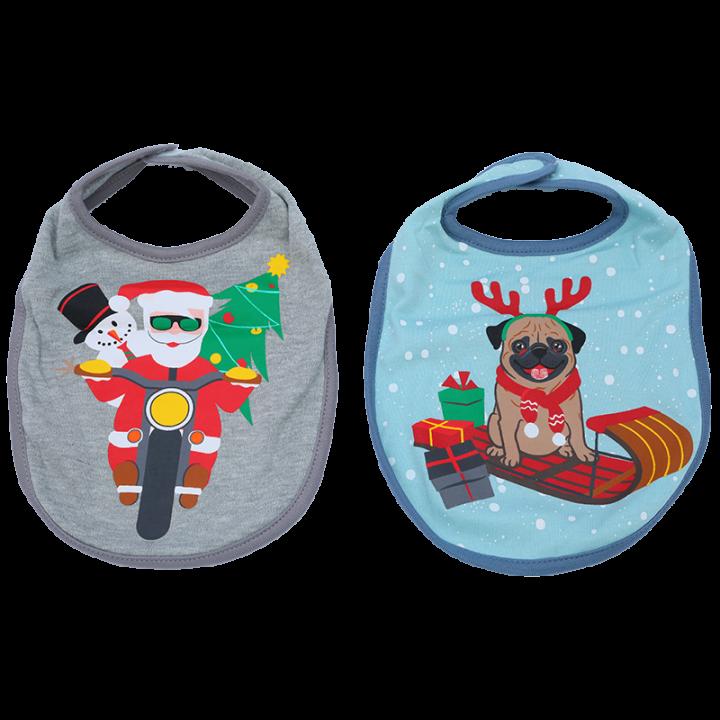 Pakkaukseen sisältyy kaksi suloista jouluaiheista ruokalappua. Kätevän tarranauhakiinnityksen ansiosta ruokalaput ovat näppärät pukea ja riisua. Joulupukki moottorpyörän päällä ja koira.