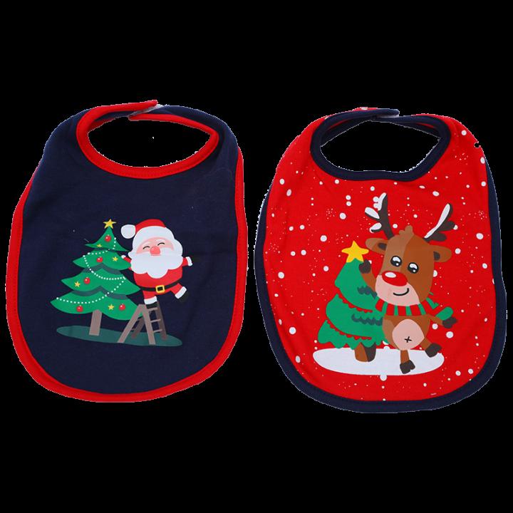 Pakkaukseen sisältyy kaksi suloista jouluaiheista ruokalappua. Kätevän tarranauhakiinnityksen ansiosta ruokalaput ovat näppärät pukea ja riisua. Joulupukki ja poro.