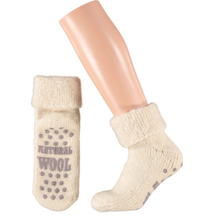 Lovely warm and soft socks for women. These comfortable non-slip socks are available in four different colors and two sizes. Color: White.
